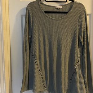 Heather grey pullover with lots of detail size M